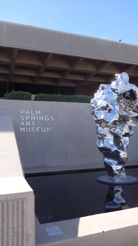 The sculpture captures the feel of a waterfall, in metal, which seems apt for a desert setting