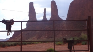 Saddles and monuments at one of our stops where we could also buy Navajo crafts.
