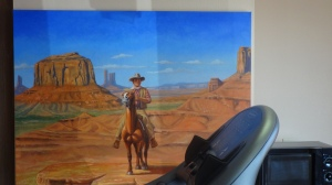 There's even a JohnWayne cabin to see but I let this copy of a kitschy painting speak for itself; it's by the treadmill in the workout room