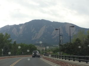 Entering Boulder, street lights and other amenities. The mountains just beyond.